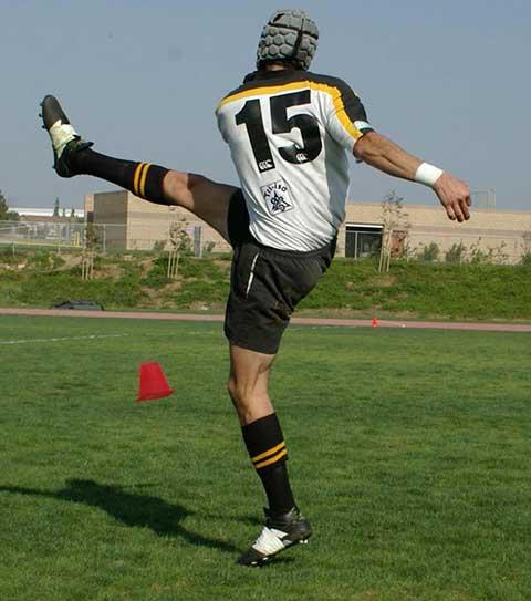 soccer player kicking high