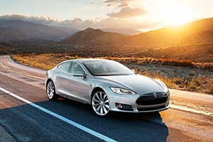 silver tesla motors model S car on road